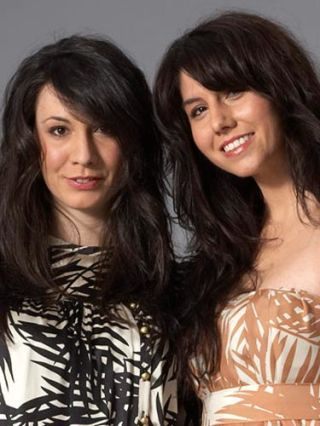 two brunettes with long wavy hair and bangs