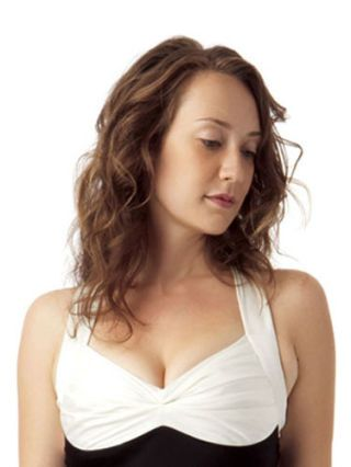 woman with shoulder length curly dark blond hair