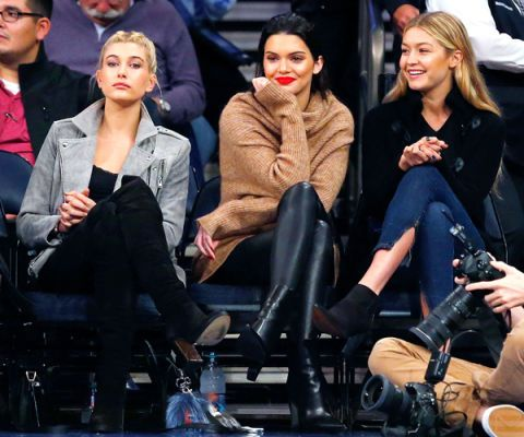 Face, Outerwear, Jeans, Jacket, Coat, Sitting, Fashion, Riding boot, Leather, Street fashion,
