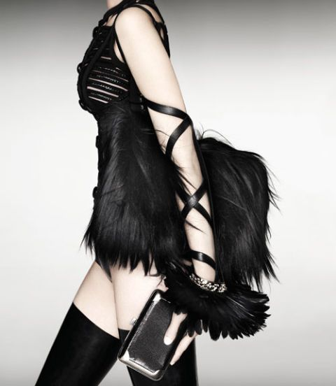 model in black feathers