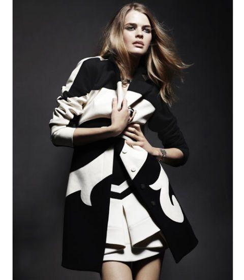 model in black and white coat