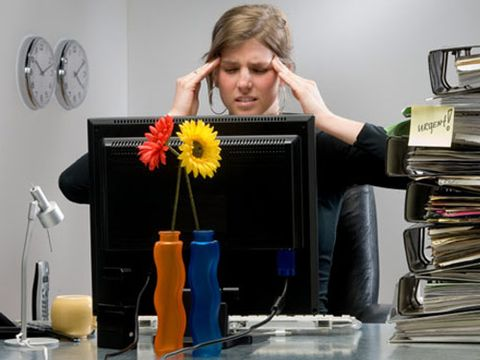 woman at desk stressed
