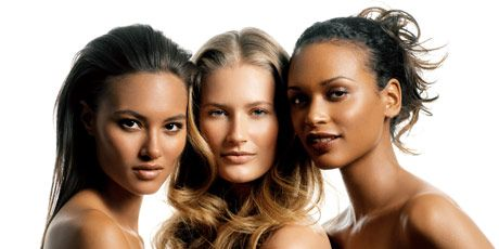 brunette and blond models with hair styled up and down