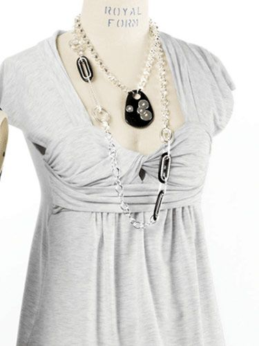 gray top with necklaces