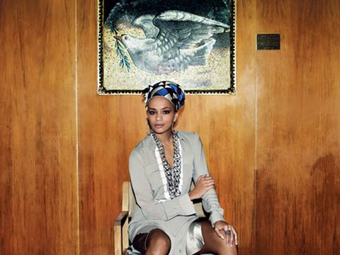 model in gray and metallic dress and blue and black head scarf