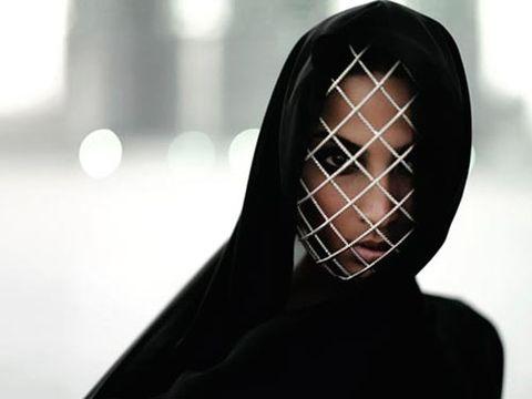 dubai model wearing silver mask