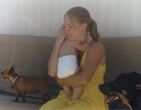 kristi mccay with her infant child and two dogs