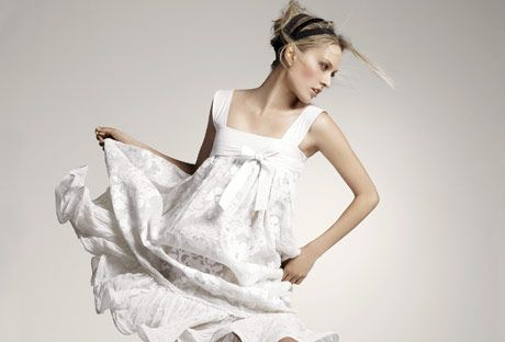 model in white sleeveless dress and white espadrilles