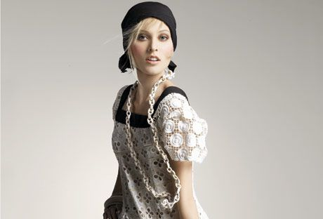 model in white dress and black head scarf