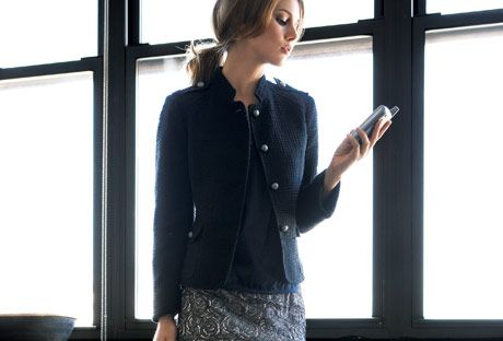 woman in black blazer and lace skirt