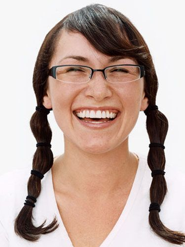 girl with glasses and pigtails