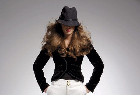 model in wide leg white trousers and black velvet jacket