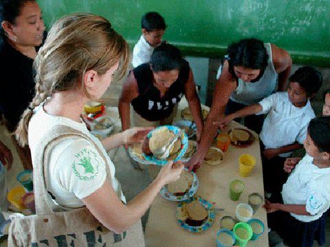 women and chidren eating