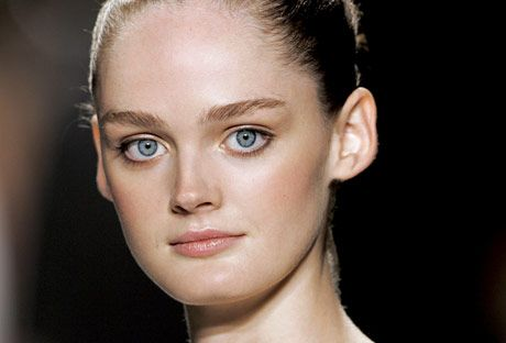 model with blue eyes and bun