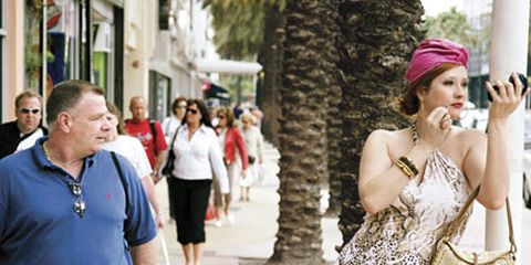 man staring at woman in pink turban