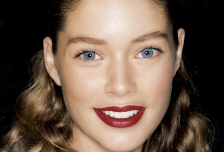woman with dark red lipstick and blue eyes