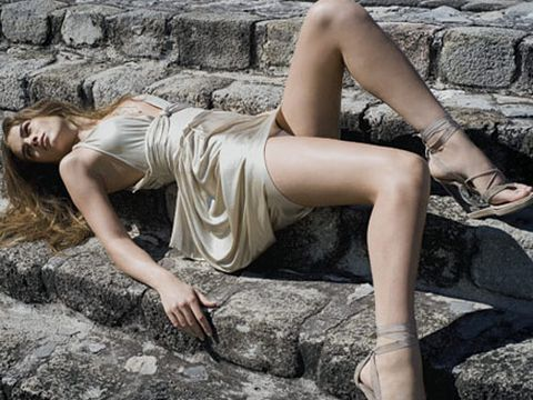 girl laying on stairs in gold dress