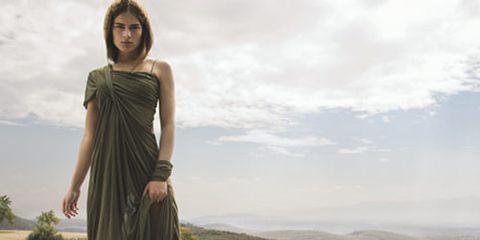 model in green dress on hillside