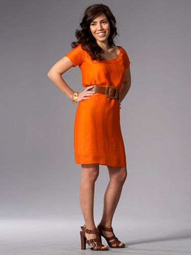 woman in bright orange dress