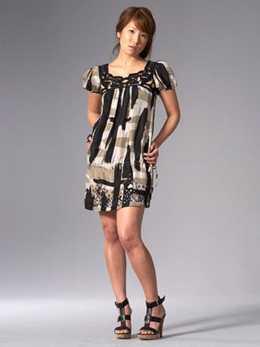 woman in black, white and brown tribal print dress