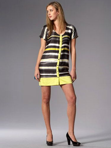 woman in yellow tribal print dress