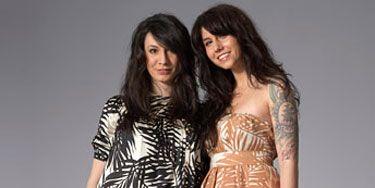 two women in tribal print dresses