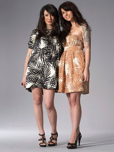 two women in tribal print dresses