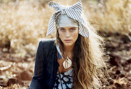 woman in head scarf sitting outside