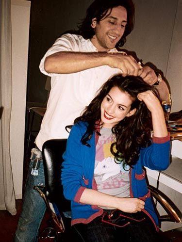 anne hathaway getting hair styled for photo shoot