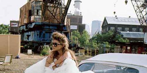 ashley olsen in white dress on car
