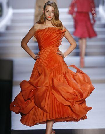 model in orange dress