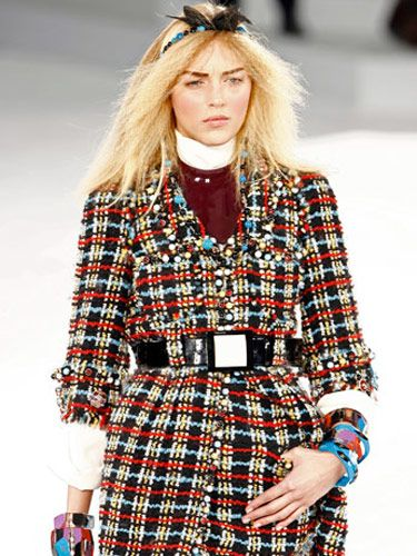 model in plaid coat