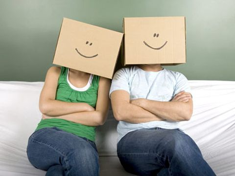 guy and girl with cardboard boxes over their heads with painted smiley faces