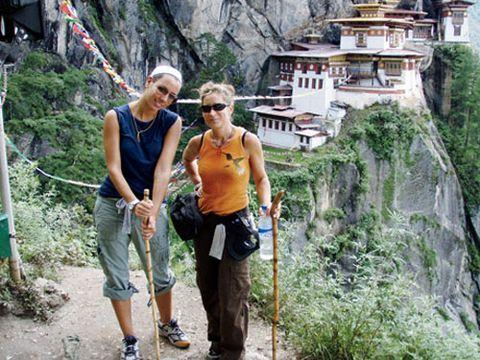 women on mountainside in bhutan