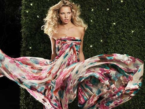 woman swirling a strapless bold print gown
