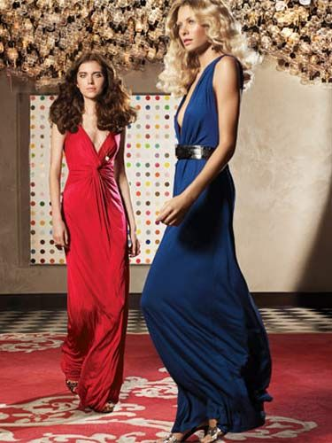 women in long red and blue dreses