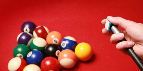 billiard balls and pool stick