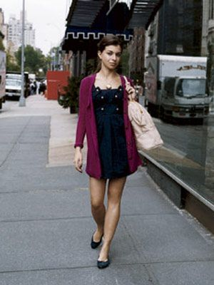 woman walking down street in black bcbgirls dress and maroon bretti cardigan