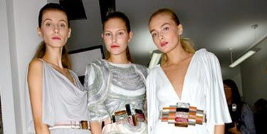 three women in crafty belts by fendi with colored stones and applique