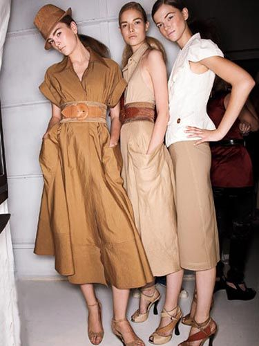 three women in neutral colored skirts and dresses from donna karan collection