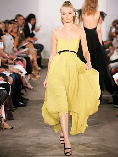 model on runway in day glo yellow dress by jason wu