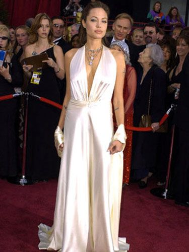 angelina jolie in a white halter dress at the 76th annual academy awards