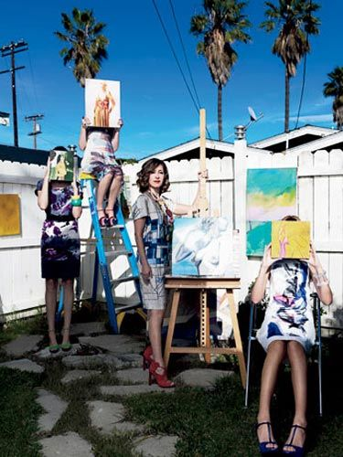 painter kimberly brooks at her venice california studio with her paintings and some designer dresses