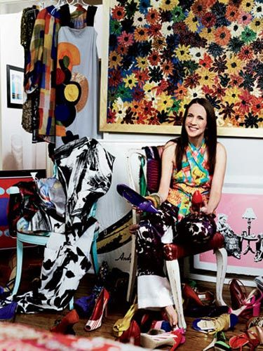 art collector flanked by her warhol and banksy originals