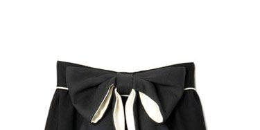 black knee length skirt with black bow across waist