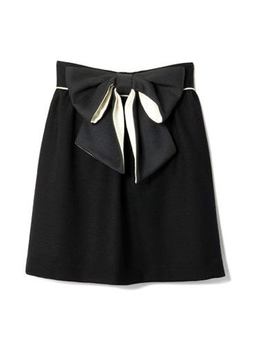 black knee length skirt with black bow across waist