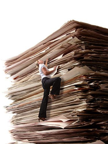 woman climbing stack of paper work