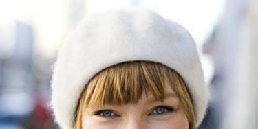 girl with blonde hair and white beret
