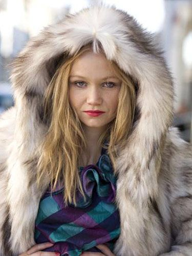 girl with blond hair and big fur coat