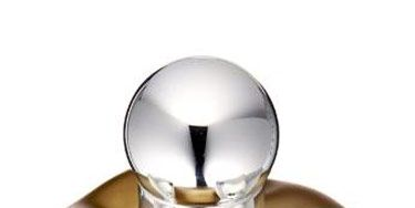 silver and gold bottle of perfume
